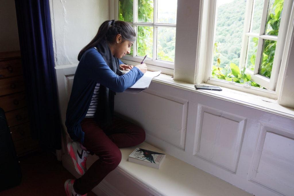 Girl writing at Arvon