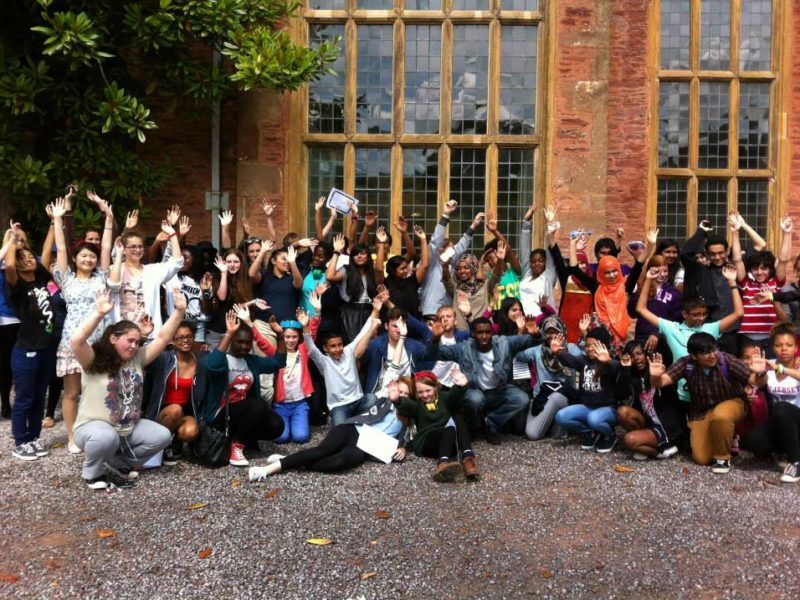 Young writers outside Nettlecombe at the 2013 First Story Residential