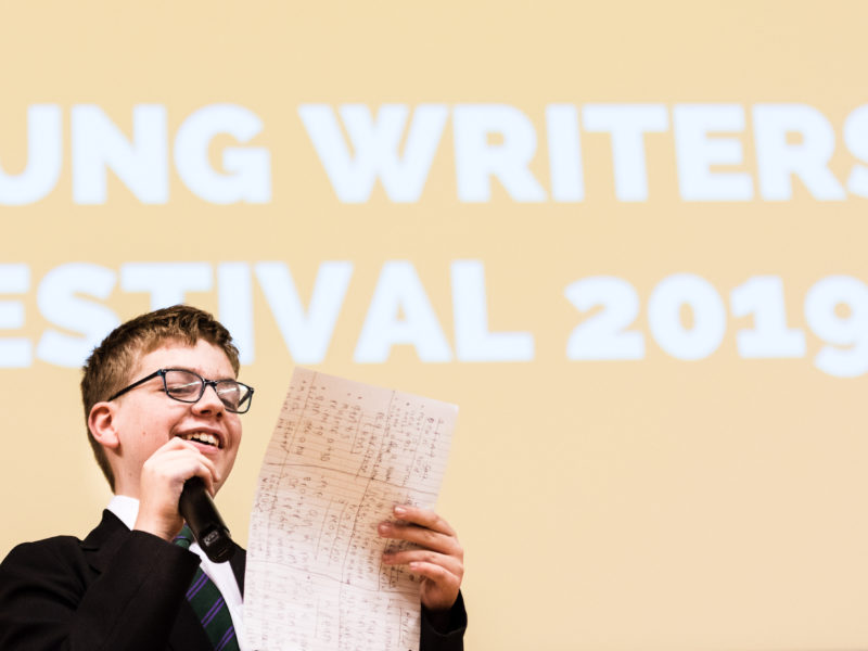 Young Writers' Festival 2019 - boy reading on stage